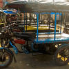 These are traditional auto rickshaws (three wheelers) used in India.
