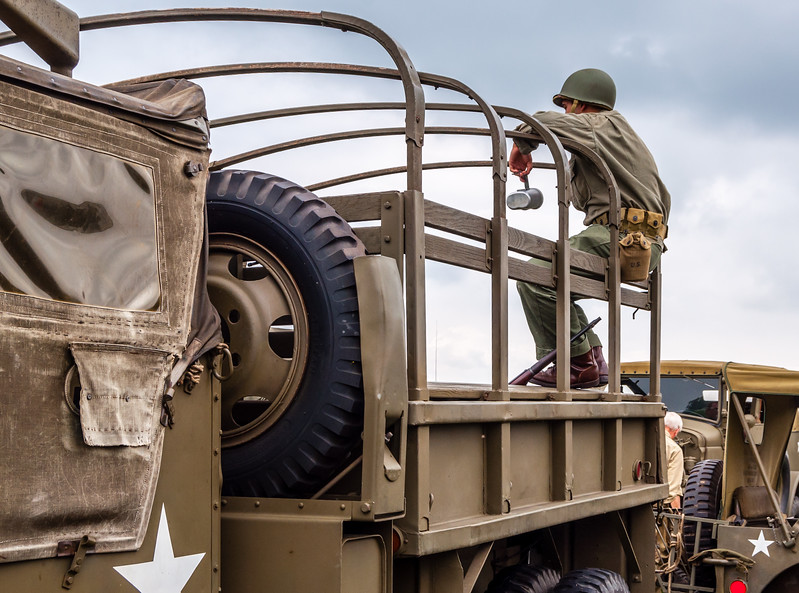 US Soldier on a Deuce-and-a-Half Truck