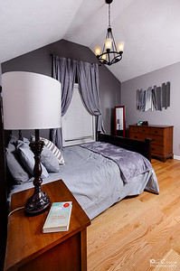 The Feature Wall And Chandelier In The Master Suite.