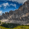 Dappled light on cliffs and meadows, Dolomites, Italy. 5-September-2019