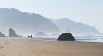 People Walking on Beach in Mist at Hug Point, Oregon