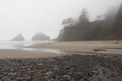 The Old Haceta Lighthouse Keeper's residence in fog on the Oregon coast.