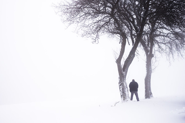 Man in foggy Winter