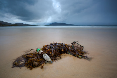 Seaweed and some ocean debris provided some foreground interest for this view of Ceapabhal from Tràigh Lar near Horgabost on the Isle of Harris, Outer Hebrides, Scotland.
