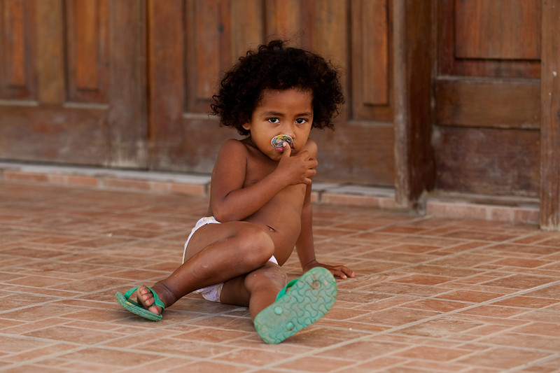this little girl was sitting alone on the porch of a Seventh Day Adventist church.  No parent or adult supervision anywhere in site.  This church sits next to the main road in Coxen Hole.