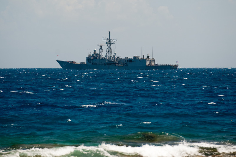 A US Navy Frigate sits just off shore waiting to come ashore and help with the rebuilding of the Alfredo School which Ted and Cam helped to make happen.