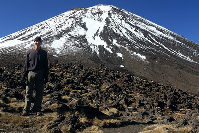 Mt. Ngauruhoe -  am active strata volcano, rising to about 7,500 ft. (2,286 m), 2nd highest peak on North Island.  As see from here along the Tongariro Alpine Crossing track, viewing SWward at about 6,035 ft. (1,840 m) from the saddle which connects and forms the crater rim with Mt. Tongariro to the NW - Tongariro NP - Manawatu-Wanganui region