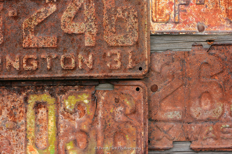 DF.1899 - detail of old license plates, Molson Ghost Town Museum, WA.