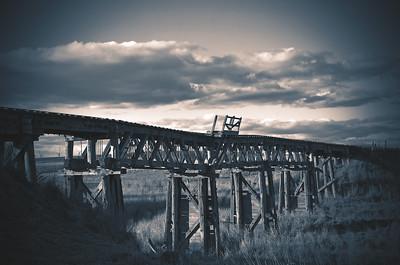 Monotone abandoned wooden railway bridge