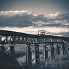 Monotone abandoned wooden railway bridge