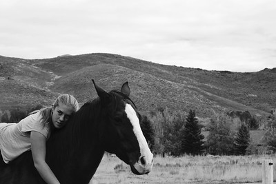 A little dark, but you can take care of that in Photoshop.  I might have filled the frame with the entire composition of Devan and her horse leaving the relative plain background out of the picture entirely.