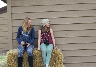 I like this shot of the girls on the hay bale.  The obvious lines of the siding give you immediate feedback if you are holding the camera level.  This is more challenging than you might think.  Shooting at the ocean trains you to keep the camera level as it is easy to tilt one way or the other and then it looks like the ocean is going to pour out of one side of the camera.  Cropping in photoshop will take care of this.