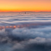 Above the Clouds San Francisco, CA   Low marine fog blankets the San Francisco bay covering much of the city skyline during sunrise.
