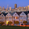 The Painted Ladies San Francisco, CA   Victorians line the streets with the San Francisco skyline peering from behind.