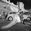 Emily and Magnus with their vintage Rolls Royce wedding car outside the Grange Hotel