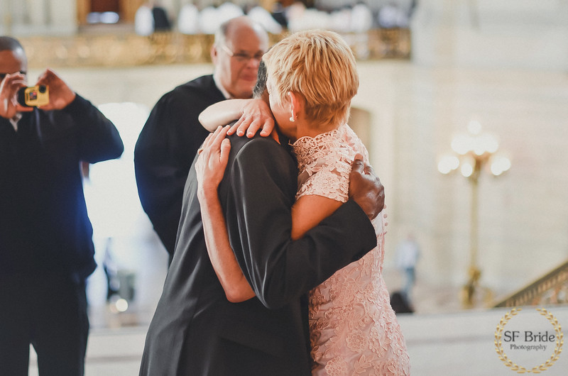 Couple just got married and hugging each other