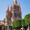 The Parish church, Parroquia de San Miguel Archangel, fashioned after the Familia Sagrada in Barcelona. It is made of pink limestone.