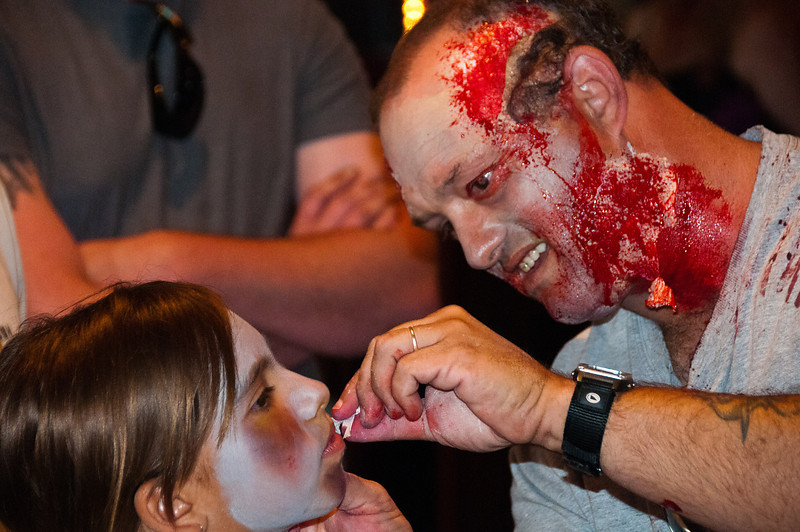 "The 5th annual Zombie Walk at San DIego's Comic-Con begins with getting all ""zombied up.""."