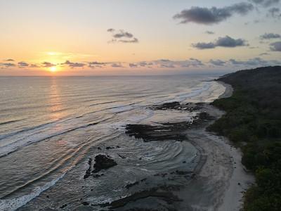 Lush Tropical Beach Paradise with blue water, great waves and rock formations in Malpais / Santa Teresa, Nicoya Peninsula Costa Rica