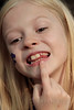 """Alexandria points out her loose tooth. """"I'm having a blood drink."""""""