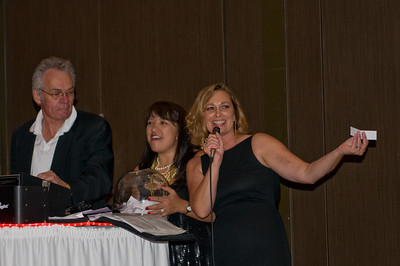 Steve LaGrutta, Deanna Bartee and Kim Collins announcing Door Prize Winners