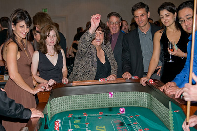 Sharon Osias throws the dice at the Craps Table