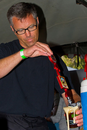 Mistral's owner Toby McMillan pours a cold one