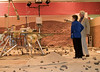 (2.13.2008 -- Tucson, AZ)  Dr. Peter Smith, Principal Investigator of the Phoenix Mars Mission points out various components of lander to Arizona Governor Janet Napolitano.