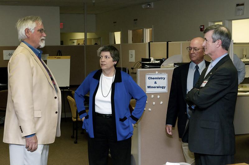 (2.13.2008 -- Tucson, AZ)  Dr. Peter Smith (left) Principal Investigator of the Phoenix Mars Mission briefs Arizona Governor Janet Napolitano while Dr. Michael Drake and University of Arizona President Robert Shelton look on.