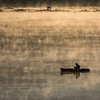 A fisherman readies his line as morning fog rises up from the Susquehanna River just after sunrise in Darlington, Maryland.
