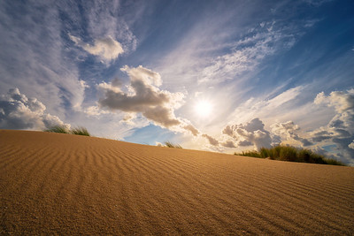 Sand, clouds and sun