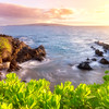 Ah, my sweet home, Maui. There's no place on earth quite like it.  I shot this on the South side at sunset one evening as I was out with my wife and son. I love the way the soft light glistens on the naupaka plants in the foreground and the swirling ocean dances over the lava rocks on the coast. Off in the distance is the island of Kaho'olawe with Molokini being the smaller island in the foreground.