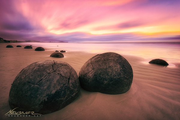 They almost look like stone turtles, don't they? These are the Morekai Boulders in New Zealand. How they got there and where they came from are a mystery. There are several dozen of them along the beaches in this area and lots of theories surrounding them, but as far as I know, no universal consensus on the origin of them.<br /> <br /> I shot this at sunrise and it was as awesome as it looks here. Just being there was special and contemplating these giant stones was thought provoking as well. To give you an idea, these two in the foreground are probably about 8 feet in diameter, maybe more. Definitely bigger than a smart car or VW bug.