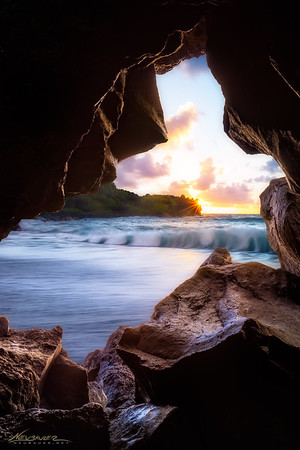 Sunrise is my favorite part of the day. It's even more special on Maui where you have to work to get to a spot like this before the sun comes up. To me, being in that spot, being set up and ready to photograph the sun as it rises above the horizon and the vast blue Pacific Ocean is something magical.<br /> <br /> This little window through the lava rocks on Maui was a fantastic place to watch the sun rise and the waves crash on the black sand beaches of Hana.