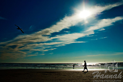 View of the beach with silhouette of people and birds.  Backlighting shot at Cannon Beach, Oregon Coast.  © Copyright Hannah Pastrana Prieto