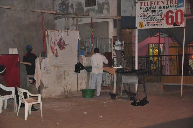 Outdoor butchery on Main Street in downtown Saly, Senegal