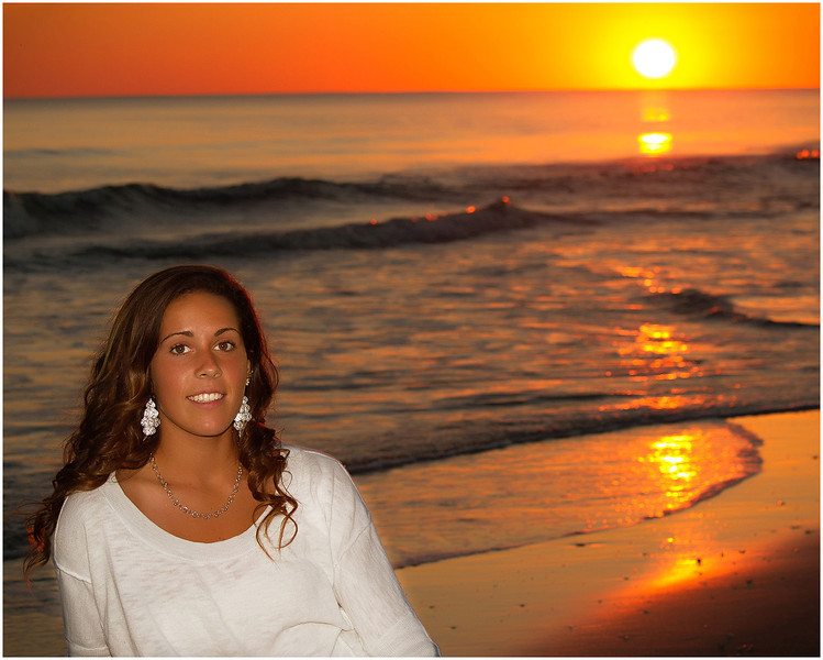 Professional portrait of a senior at Fort Macon Beach State Park North Carolina at sunset.