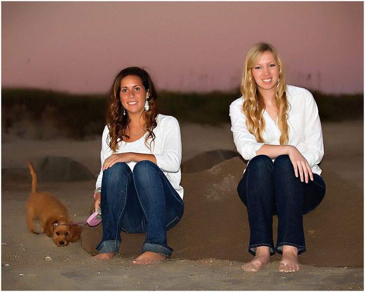 Professional lifestyle portrait of seniors at Fort Macon Beach State Park North Carolina with their puppy at the beach.
