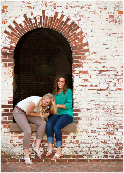 Professional portrait of senior sisters at Fort Macon State Park North Carolina at the fort.