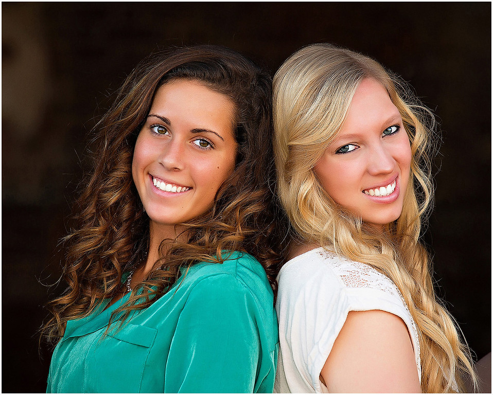 Professional portrait of senior sisters at Fort Macon Beach State Park North Carolina.