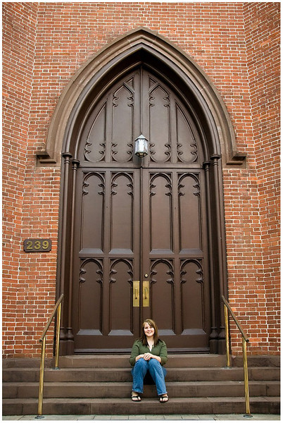 Professional lifestyle portrait of a senior in downtown New Bern, NC in front of First Baptist Church
