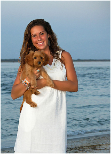 Professional lifestyle portrait of a senior at Fort Macon Beach State Park North Carolina with her dog.
