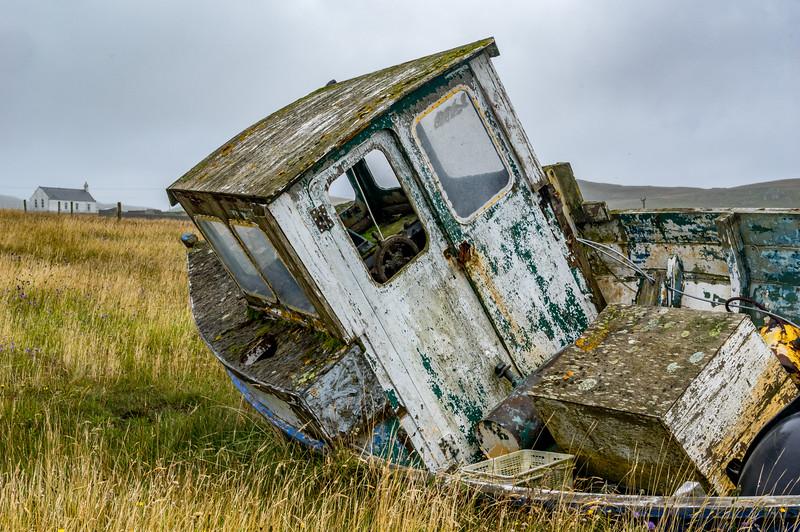 Old boat in a field, North Roe, NE coast of Northmavine.