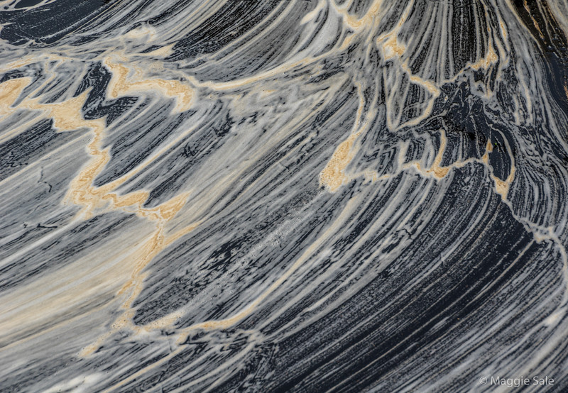 Scum patterns in the harbour, east coast, Northmavine