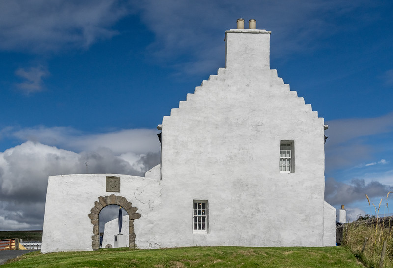 The Old Haa, Museum of local life at Burravoe, Yell. The arched buttress used to be over the road that passed by the house which dates from 1672. There is a cafe and art gallery attached, with a lovely walled garden (a rarity in Shetland) which is well maintained.