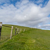 Headland walk at Hillswick, Northmavine. This fence was built to guide the lighthouse keeper to the lighthouse in bad weather!