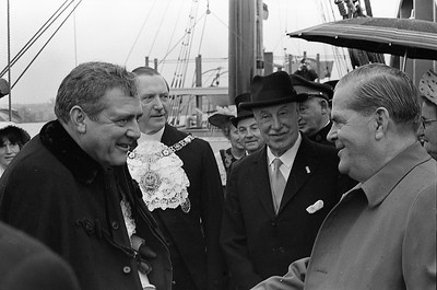 Actor Raymond Burr, left, greets British Columbia premier W.A.C. Bennett during an anniversary celebration in New Westminster, B.C. Behind them are the mayor of New Westminster and the Lieutenant Governor of B.C. Burr, a native of New Westminster, played Perry Mason in the long-running TC series.(CP Wirephoto) 1965 (Wally Hayes)