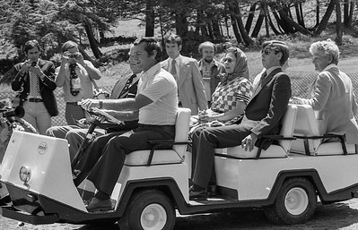"""This photo appeared across 8-columns of the Toronto Globe and Mail's front page under the caption 'The Royal Lurch"""" the day after it was taken in Bromont, Quebec, prior to  the Queen opening the Olympic Games in Montreal in 1976. The Queen was in Bromont to inspect the Olympic equestrian course where Princess Anne was competing. She and Prince Phillip and Prince Andrew boarded a golf cart to tour the course, but the driver, Johnny Ferguson, a Montreal Canadiens hockey star, got a little lead footed and the cart started abruptly throwing his royal passengers back in their seats. A subsequent photo shows them all having a great laugh over the incident. (CP Wirephoto) 1976 (Wally Hayes)"""