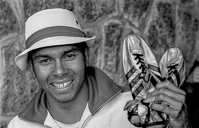 Sprinter Harry Jerome of North Vancouver, BC., holds up the gold track shoes he wore while competing at the 1968 summer Olympics in Mexico City. Jerome  set seven  world records during the 1960s and competed in four Olympics. He died of a brain aneurysm in 1982 at the age of 42. (CP Wirephoto)1968(Wally Hayes)