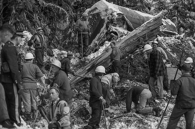 Rescuers dig through rock, mud and broken timbers in an effort to rescue the driver of the tanker truck (background) that was caught up a landslide in the early morning hours of Jan. 9, 1965. The avalanche was said to be the largest ever recorded in Canada. The driver of the truck was found dead. Three other people in two vehicles also perished. Although the body of the truck driver was recovered, the bodies of two other were not and then remain buried on the mountainside a few kilometres east of Hope, BC. (CP Wirephoto)1965(Wally Hayes)